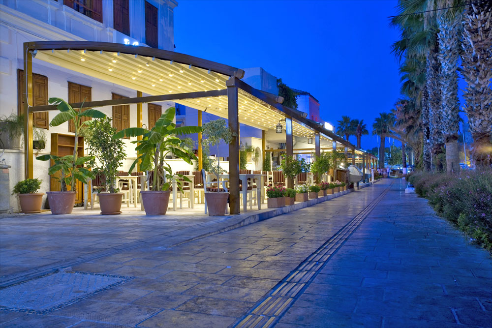 Radian pergola with lighting in bar terrace at night