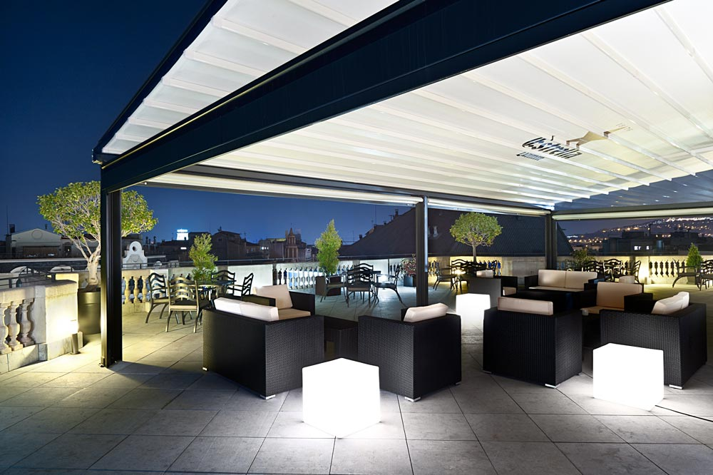 Pergola eva at night with advertising and lighting on the terrace