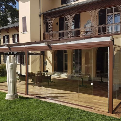 Asgard pergola in brown color with glass enclosures