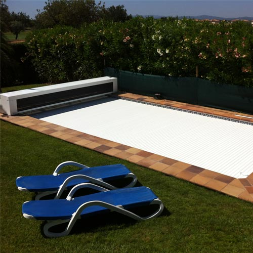 Box slatted pool deck in garden with hammocks