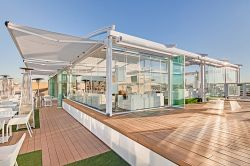 Radian Pergola closed with glass in bar terrace