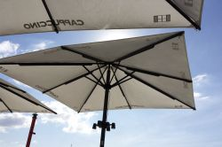 Bahia parasol with lamps in the masta protection on sunny days