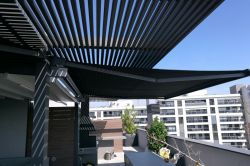 Awning Cofre Light in black color in a private house