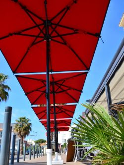 Five Ibiza parasols with red canvas