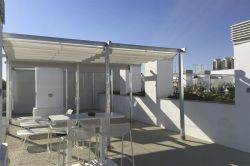 Awning Giralda on terrace with pool and sea views