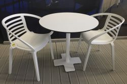 White round table with white chairs