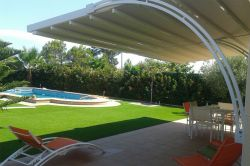 Pergola adara in garden with swimming pool