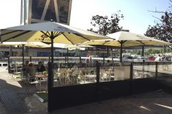 Comfor screens next to parasols with advertising