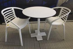Monobloc chair with white cushion fixed