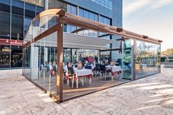 Pergola luna with platform and glass enclosures in restaurant