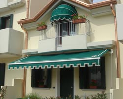 Awning eurosol 3020 green with flap on facade of private house