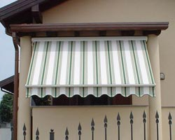 Awning eurosol semicofre 50 in window of house with garden