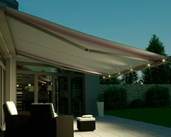 Awning Ma mx1 compact in terrace with furniture and illumination