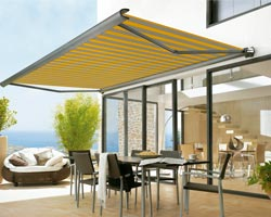 Awning mx990 yellow and gray stripes on terrace