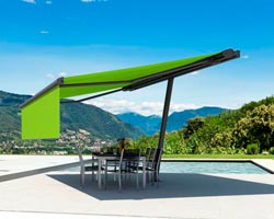 Awning ma planet in garden of chalet with swimming pool