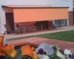 Awning ma6000 orange with front vertical flap in garden
