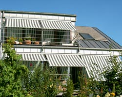 Awning ma730 striped on terrace of a chalet
