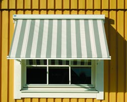 Awning ma730 striped window in a yellow house