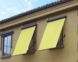 Yellow microbox awning on building windows