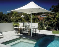 White Syrian parasol on private terrace in front of pool