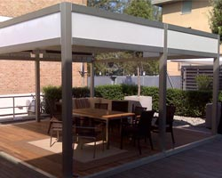 Pergola saloon on private terrace with outdoor furniture