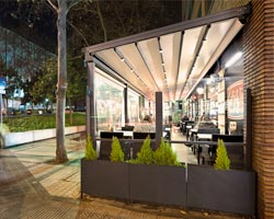 Pergola eva on restaurant terrace on the sidewalk of a city