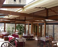 Kassia pergola with wooden structure in restaurant