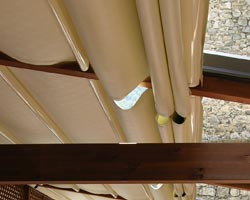 Kassia pergola with tarps in collection