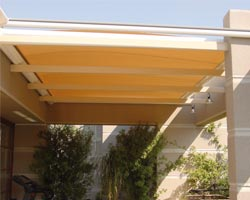 Yellow sunshade awning on terrace