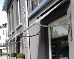 Awning stylox on gray building façade