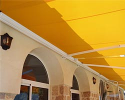 Awning eurosol supercofre yellow at home with porches