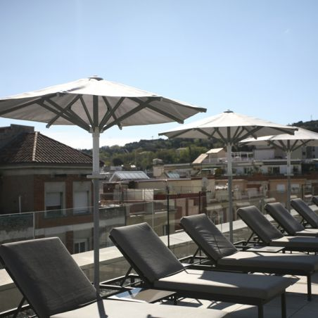 Ibiza parasols lined up on the hotel terrace