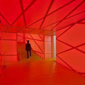 interior of the building with red lighting on the stretched canvas
