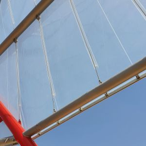 Vertical monolayer ETFE sheets in metallic structure.